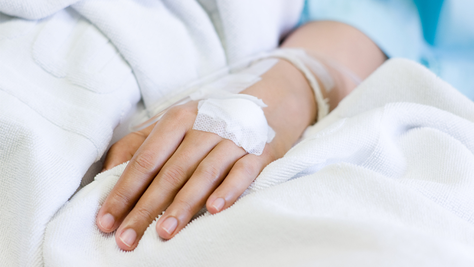 A hospital inpatient is receiving intravenous fluid, shown on the cover of the Canadian Institute for Health Information's new report Opioid-Related Harms in Canada.